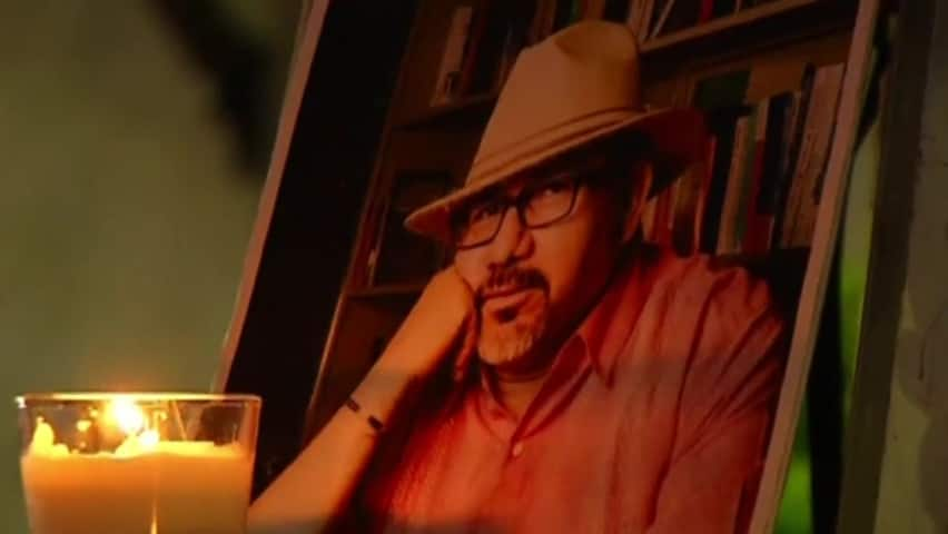 Protesters at vigil for slain journalists demand justice