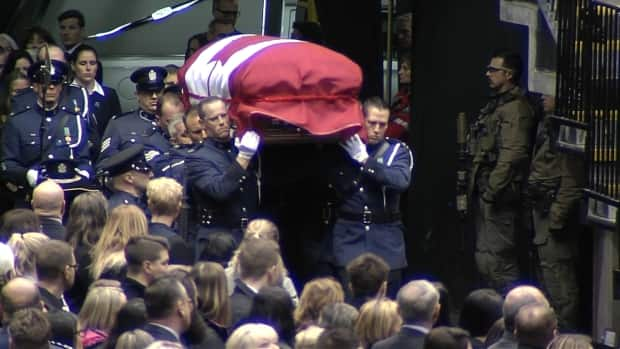 Civilians and officers pack Abbotsford Centre for fallen officer's memorial
