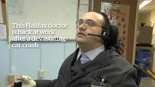 A Halifax doctor has returned to work after a car crash left him a  quadriplegic