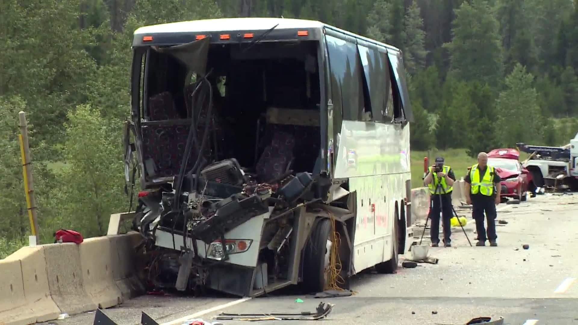Tour bus slams into tow truck