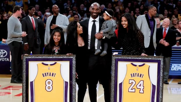 7b2a071b27c Kobe Bryant s 8 and 24 jerseys retired by Lakers
