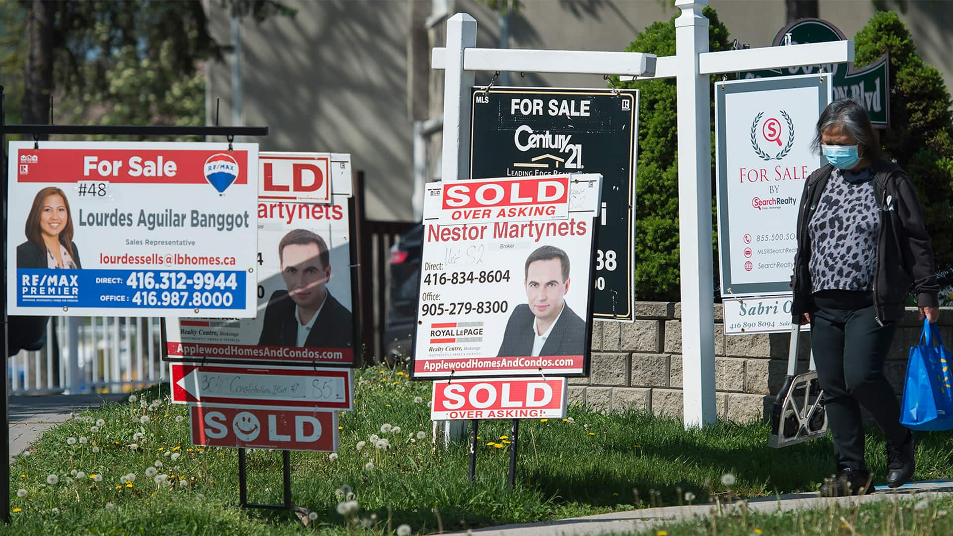 Canada and New Zealand both have hot housing markets, but only 1 has plan to cool things down