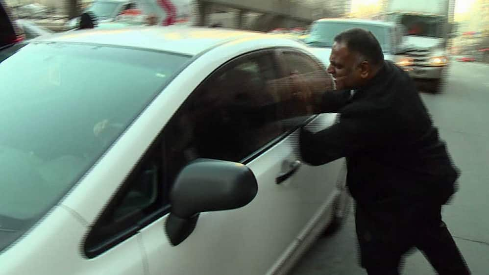 angry taxi driver confronts uber driver cbc news